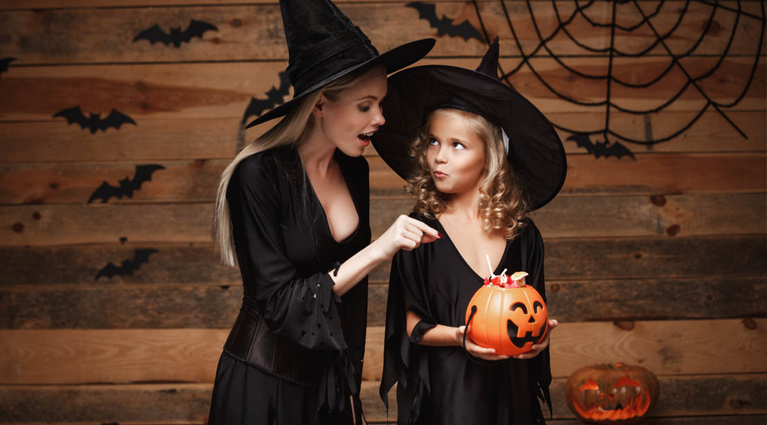Blonde mother trying to take her daughter's halloween candy