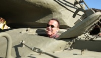Schwarzenegger Runs Over Car with Personal Tank