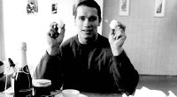 A young Bodybuilding Legend Arnold Schwarzenegger holding two hard boiled eggs for his diet for a bodybuilding physique