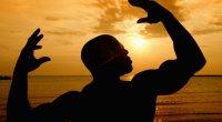 Bodybuilder sunset