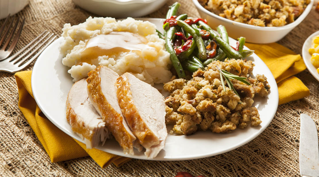 Holiday turkey and mash potatoes with a side of green beans and stuffing
