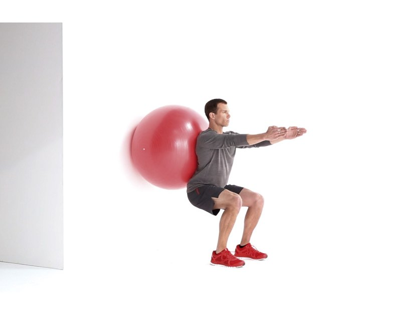 Swiss Ball Bodyweight Wall Squat Exercise Video Guide | Muscle & Fitness