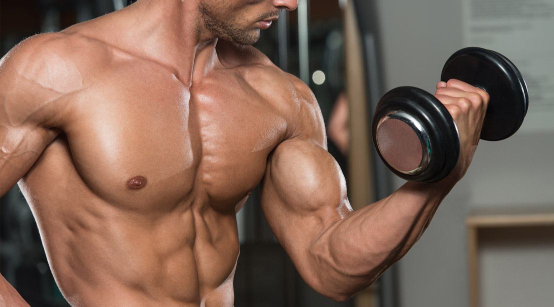 Muscular bodybuilder doing biceps workout with a bicep curl exercise