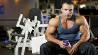 man at gym with supplement