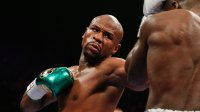 Floyd Mayweather Defends Ronda Rousey After Her Loss