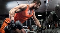 Muscular-Bodybuilder-Working-Out-With-Dumbbell-Row-At-The-Gym