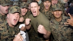 Former WWE prowrestler cheering with a group of united states armed forces