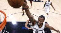 NBA star Kawhi Leonard dunking a basketball for the the San Antonio Spurs