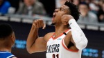 Portland Trail Blazers player Hassan Whiteside flexing his biceps