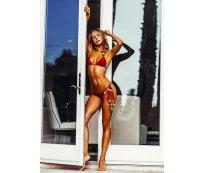 Kimberley Garner models swimsuits in holiday photo shoot