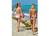 Bikini-clad models Selena Weber and Lauren-Ashley Maxey play soccer on the beach