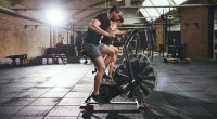 Man And Woman On Airdyne Bike At Gym