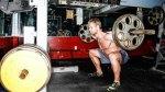 man squatting heavy weight