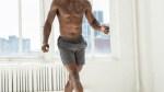 Man doing cross tuck jump exercise.