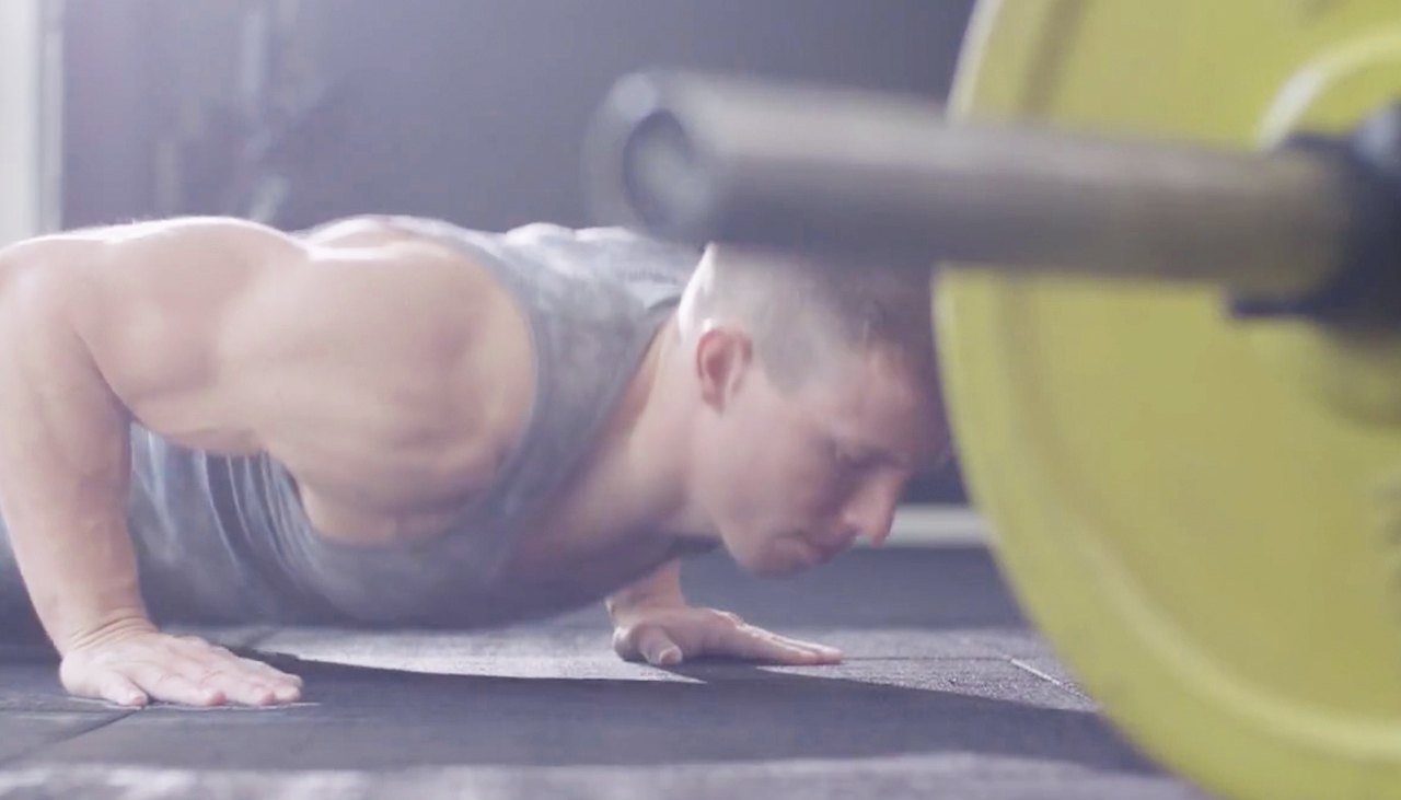 Man does burpee exercise
