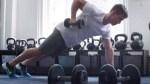 Man performs renegade row exercise