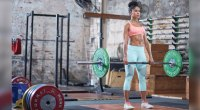 Woman Deadlifting In A Gym