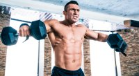 Man doing shoulder exercise: dumbbell lateral raise
