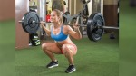 Woman In A Gym Doing A Back Squat