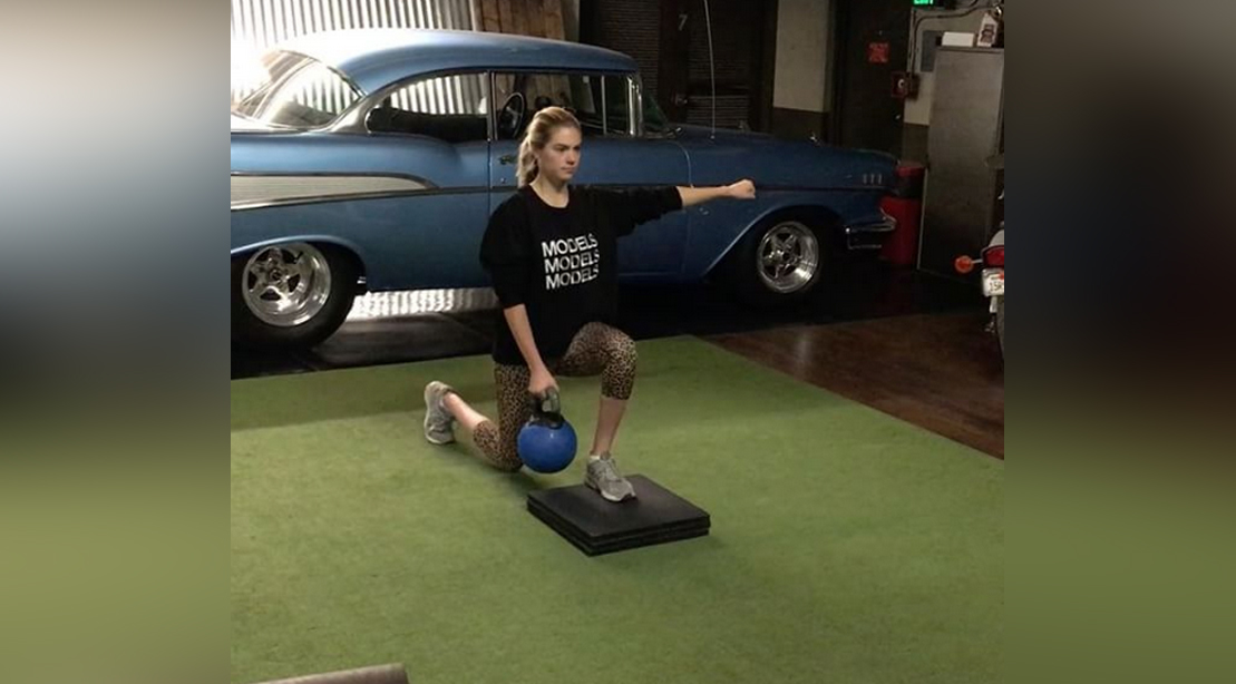 Kate Upton Performing Lunges In a Gym