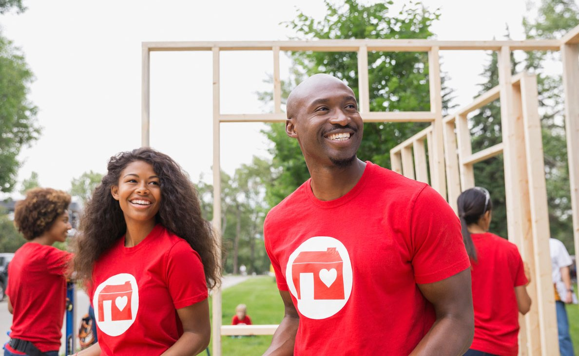 Volunteers Lift Construction Materials For Habitat For Humanity