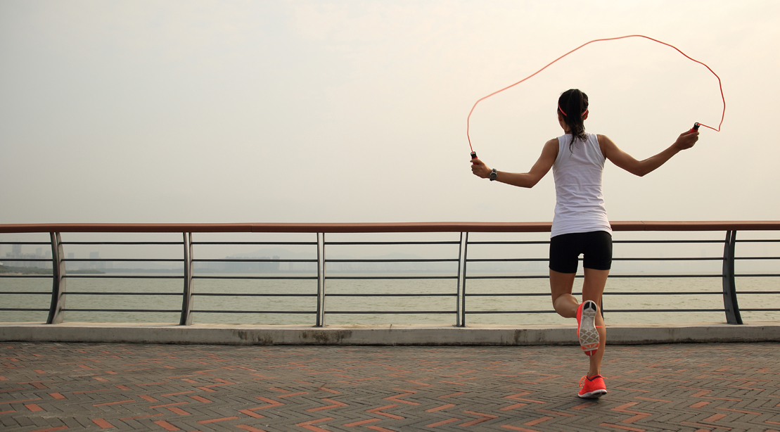 Woman Jumping Rope Outside