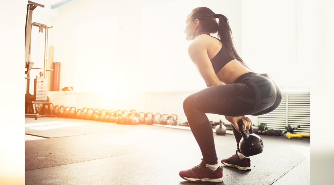 Woman Training With A Kettlebell