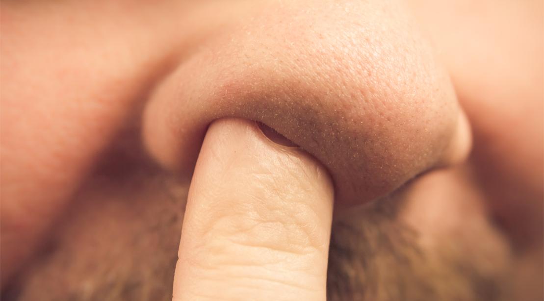 Man picking his nose.