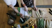 Couple cooking together with a cookbook