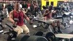 Josh Brolin performing neutral-grip shoulder raises in gym