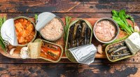 Healthy canned fish on a wooden board