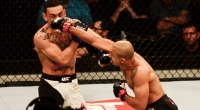 Jose Aldo of Brazil punches Max Holloway.