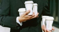 Man Holding Coffee Cups