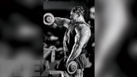 Professional bodybuilder Dorian Yates doing a shoulder workout with front dumbbell raises exercise