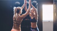 Women High Five in the Gym