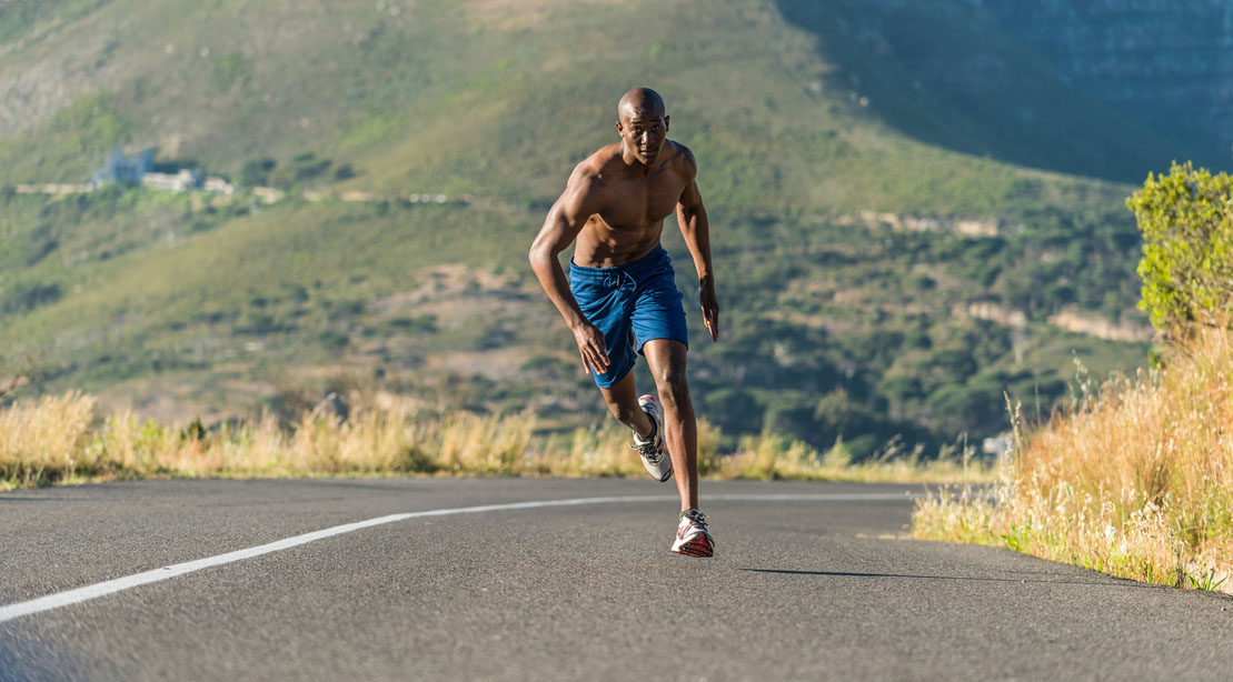 Man sprinting down the road.