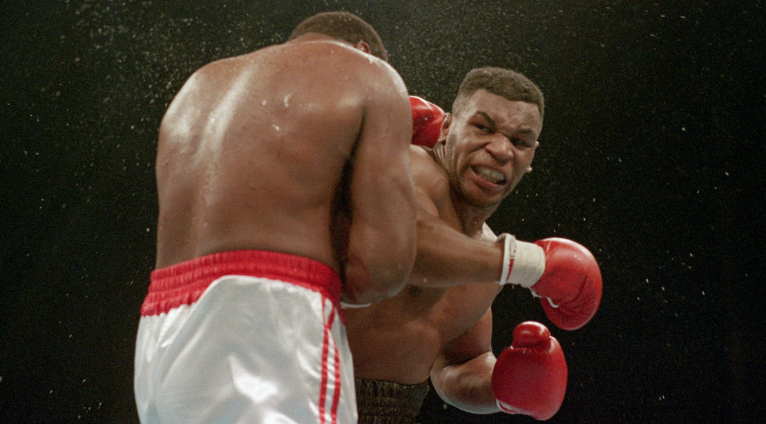 Ferocious Faced Mike Tyson Lands The Knockout Punch To The Jaw Of Challenger Larry Holmes