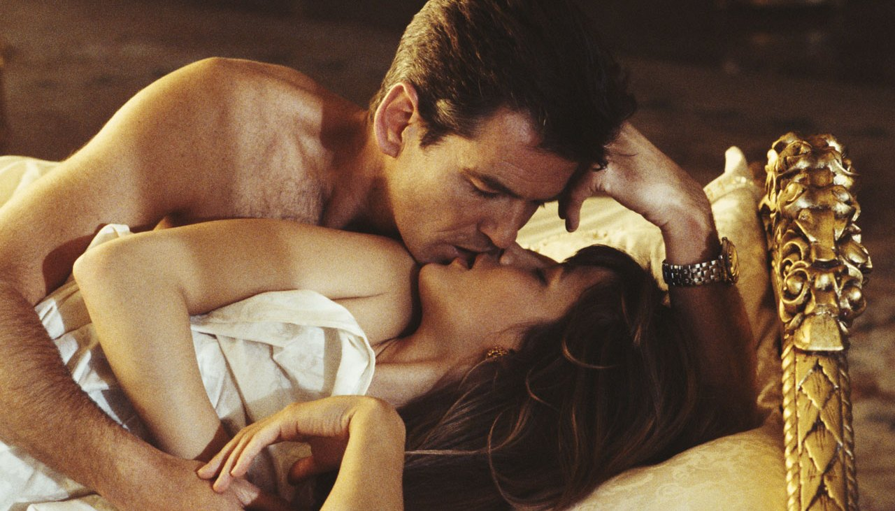 Pierce Brosnan as 007 in bed with woman