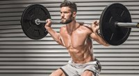 Shirtless Man Doing Barbell Back Squat