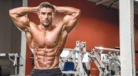 Ryan Terry posing his muscular torso