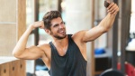 Man-In-The-Gym-Flexing-His-Biceps-Taking-A-Selfie