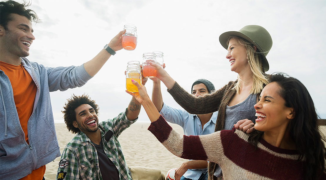 Friends drinking Non-Alcoholic Drinks and Alcoholic Drinks at the beach
