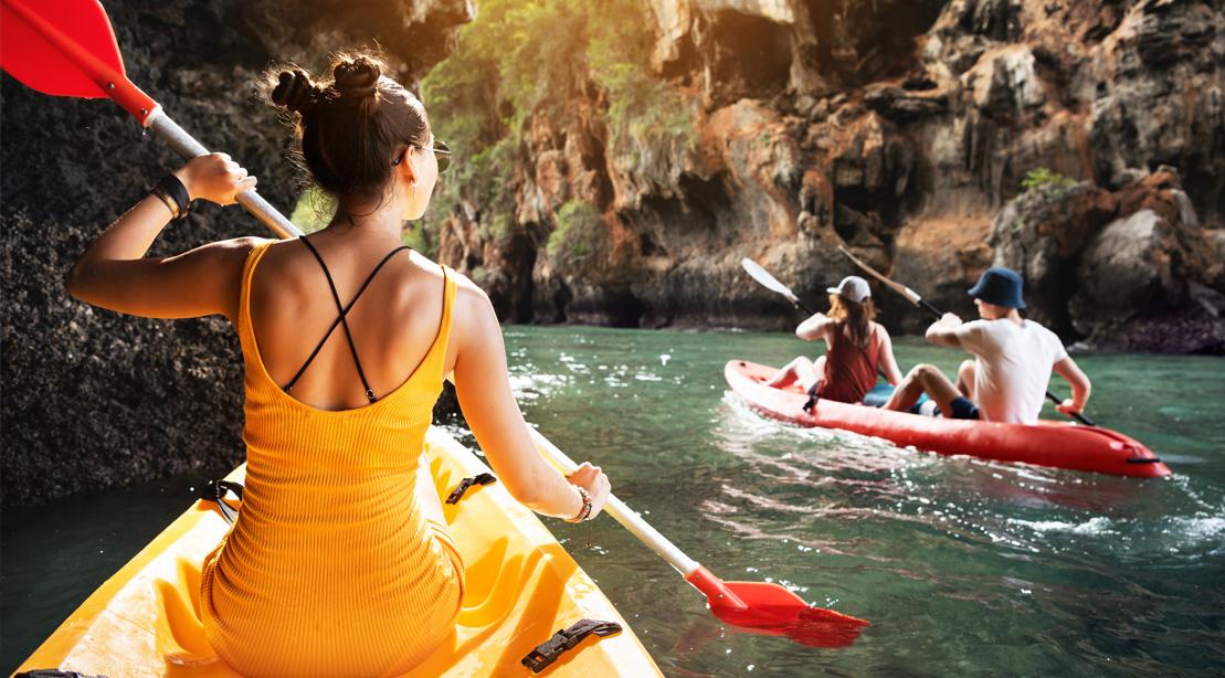 Female kayaking in cavernous river