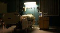 Empty Hospital Bed In Dark Room