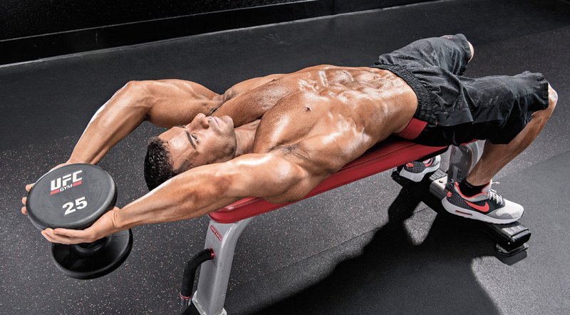 Bodybuilder and fitness model doing a arms workout routine with the tricep exercises