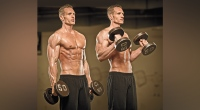 Muscular fitness model doing forearm workouts with hammer curls exercise