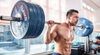 Strong man holding a heavy barbell