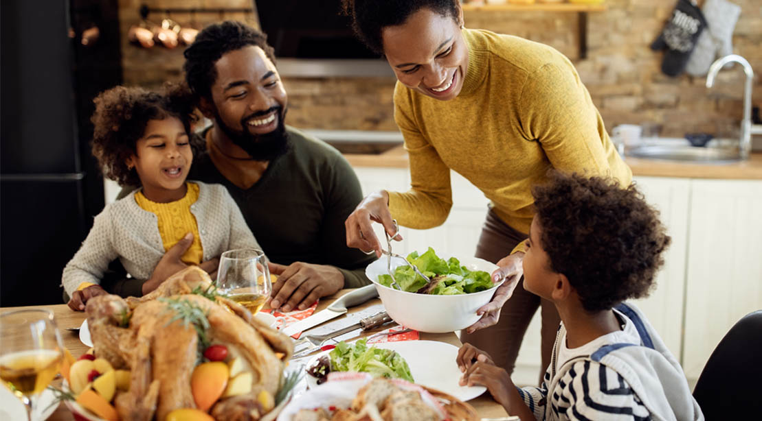 Black Family gathered around the table for the holidays