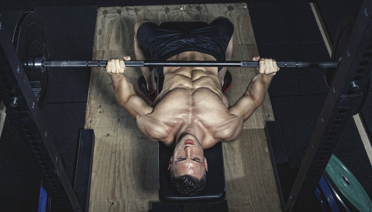 Man performing barbell bench press