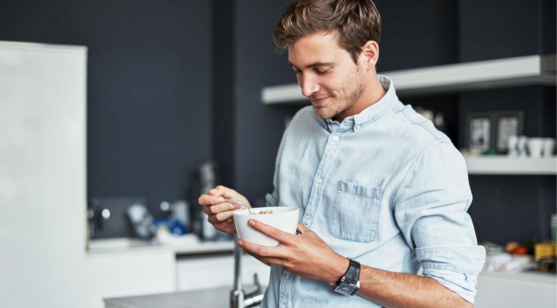 Man Eating a Bowl of Food